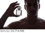 Купить «Sexy man with bottle of perfume», фото № 24714946, снято 15 ноября 2016 г. (c) Elnur / Фотобанк Лори