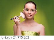Купить «Beautiful woman applying make-up in beauty concept», фото № 24715202, снято 27 сентября 2016 г. (c) Elnur / Фотобанк Лори