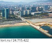 Купить «Crowded beach in Barcelona seaside», фото № 24715422, снято 8 июля 2016 г. (c) Яков Филимонов / Фотобанк Лори