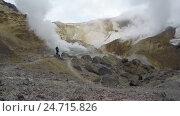 Купить «Туристы гуляют в кратере действующего вулкана Мутновский на Камчатке (4K, time lapse)», видеоролик № 24715826, снято 21 сентября 2019 г. (c) А. А. Пирагис / Фотобанк Лори