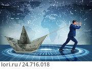 Купить «Businessman pulling boat made from dollar banknote», фото № 24716018, снято 21 ноября 2019 г. (c) Elnur / Фотобанк Лори