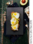Купить «Fried egg sandwich: quail eggs, avocado and cheese on whole wheat bread», фото № 24732370, снято 16 декабря 2016 г. (c) Наталия Кленова / Фотобанк Лори