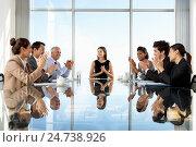 Купить «Group Of Business People Having Board Meeting Around Glass Table», фото № 24738926, снято 25 февраля 2012 г. (c) easy Fotostock / Фотобанк Лори