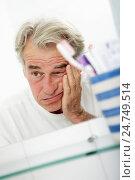 Купить «Tired Senior Man Looking At Reflection In Bathroom Mirror», фото № 24749514, снято 24 июля 2012 г. (c) easy Fotostock / Фотобанк Лори