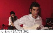 Portrait of musicians on red bacground. Стоковое видео, видеограф Chudakov_Ivan / Фотобанк Лори