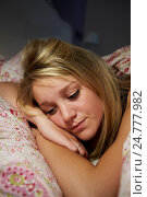 Купить «Teenage Girl Awake In Bed Suffering With Insomnia», фото № 24777982, снято 8 июля 2013 г. (c) easy Fotostock / Фотобанк Лори