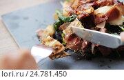 Купить «woman eating prosciutto ham salad at restaurant», видеоролик № 24781450, снято 29 сентября 2016 г. (c) Syda Productions / Фотобанк Лори
