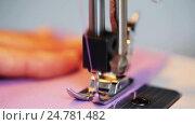 Купить «sewing machine presser foot stitching fabric», видеоролик № 24781482, снято 3 октября 2016 г. (c) Syda Productions / Фотобанк Лори