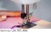 Купить «sewing machine presser foot stitching fabric», видеоролик № 24781486, снято 3 октября 2016 г. (c) Syda Productions / Фотобанк Лори