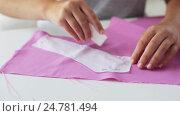 Купить «woman with pattern and chalk drawing on fabric», видеоролик № 24781494, снято 3 октября 2016 г. (c) Syda Productions / Фотобанк Лори