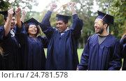 Купить «happy students in mortar boards with diplomas», видеоролик № 24781578, снято 6 октября 2016 г. (c) Syda Productions / Фотобанк Лори