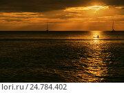 Купить «Одинокий серфер в море на закате», фото № 24784402, снято 13 ноября 2016 г. (c) Галаганов Дмитрий Александрович / Фотобанк Лори