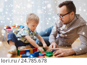 Купить «father and son playing with toy blocks at home», фото № 24785678, снято 19 марта 2016 г. (c) Syda Productions / Фотобанк Лори