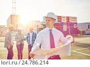 Купить «architect with blueprint on construction site», фото № 24786214, снято 21 сентября 2014 г. (c) Syda Productions / Фотобанк Лори