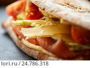 Купить «close up of panini sandwich with salmon and cheese», фото № 24786318, снято 22 сентября 2016 г. (c) Syda Productions / Фотобанк Лори