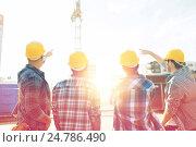 Купить «group of builders in hardhats at construction site», фото № 24786490, снято 21 сентября 2014 г. (c) Syda Productions / Фотобанк Лори