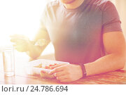 Купить «close up of man with fork and water eating food», фото № 24786694, снято 14 мая 2015 г. (c) Syda Productions / Фотобанк Лори