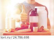 Купить «man with protein food showing thumbs up», фото № 24786698, снято 14 мая 2015 г. (c) Syda Productions / Фотобанк Лори