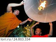 Купить «Monks launch hot air balloon Loy Krathong festival Mae Hong Son Thailand.», фото № 24803334, снято 24 августа 2019 г. (c) age Fotostock / Фотобанк Лори