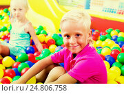 Купить «Boy sitting and playing with multicolored plastic balls», фото № 24806758, снято 26 июня 2019 г. (c) Яков Филимонов / Фотобанк Лори