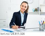 Купить «Adult woman working with paperwork and laptop», фото № 24811326, снято 24 мая 2019 г. (c) Яков Филимонов / Фотобанк Лори