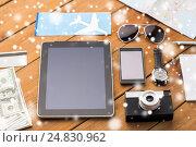 Купить «tablet pc, smartphone, airplane ticket and camera», фото № 24830962, снято 8 февраля 2016 г. (c) Syda Productions / Фотобанк Лори