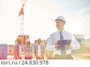 Купить «happy builders and architect at construction site», фото № 24830978, снято 21 сентября 2014 г. (c) Syda Productions / Фотобанк Лори