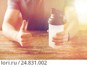 Купить «man with protein shake bottle showing thumbs up», фото № 24831002, снято 14 мая 2015 г. (c) Syda Productions / Фотобанк Лори