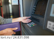 Купить «close up of hands withdrawing cash at atm machine», фото № 24831098, снято 8 сентября 2016 г. (c) Syda Productions / Фотобанк Лори