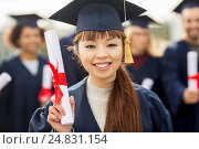 Купить «close up of happy student or bachelor with diploma», фото № 24831154, снято 24 сентября 2016 г. (c) Syda Productions / Фотобанк Лори