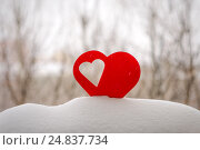 Купить «Beautiful hearts on a winter background», фото № 24837734, снято 6 января 2017 г. (c) Захар Гончаров / Фотобанк Лори