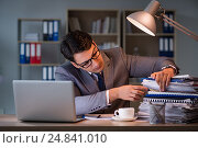 Купить «Businessman staying in the office for long hours», фото № 24841010, снято 18 октября 2016 г. (c) Elnur / Фотобанк Лори