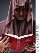 Купить «Monk in religious concept on gray background», фото № 24841734, снято 26 октября 2016 г. (c) Elnur / Фотобанк Лори