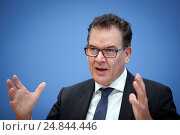 Berlin, Germany, press conference on the consequences of migration, a Marshall Plan with Africa, Dr. Gerd Mueller, CSU, Federal Minister for Economic Cooperation and Development (2016 год). Редакционное фото, агентство Caro Photoagency / Фотобанк Лори
