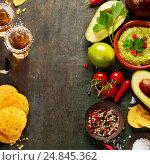 Купить «Bowl of guacamole with fresh ingredients and tequila shots», фото № 24845362, снято 6 декабря 2016 г. (c) Наталия Кленова / Фотобанк Лори