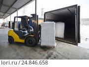 Купить «Forklift in warehouse loading box into a car outdoors», фото № 24846658, снято 13 декабря 2016 г. (c) Андрей Радченко / Фотобанк Лори