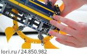Купить «child plays with toy excavator from the constructor», видеоролик № 24850982, снято 8 января 2017 г. (c) Володина Ольга / Фотобанк Лори