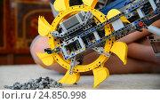 Купить «child plays with toy excavator from the constructor», видеоролик № 24850998, снято 8 января 2017 г. (c) Володина Ольга / Фотобанк Лори