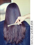 Купить «hand with comb combing woman hair at salon», фото № 24854658, снято 15 февраля 2015 г. (c) Syda Productions / Фотобанк Лори