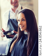 Купить «happy young woman coloring hair at salon», фото № 24854662, снято 15 февраля 2015 г. (c) Syda Productions / Фотобанк Лори