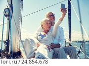 Купить «seniors with smartphone taking selfie on yacht», фото № 24854678, снято 18 августа 2015 г. (c) Syda Productions / Фотобанк Лори