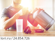 Купить «close up of man with protein shake bottle and jar», фото № 24854726, снято 14 мая 2015 г. (c) Syda Productions / Фотобанк Лори