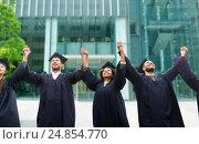 Купить «happy students or bachelors celebrating graduation», фото № 24854770, снято 24 сентября 2016 г. (c) Syda Productions / Фотобанк Лори