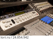 Купить «music mixing console at sound recording studio», фото № 24854942, снято 18 августа 2016 г. (c) Syda Productions / Фотобанк Лори