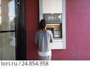 Купить «close up of woman at atm machine outdoors», фото № 24854958, снято 8 сентября 2016 г. (c) Syda Productions / Фотобанк Лори