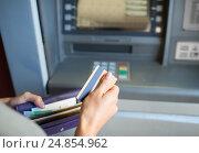 Купить «hands with money and credit card at atm machine», фото № 24854962, снято 8 сентября 2016 г. (c) Syda Productions / Фотобанк Лори