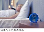 Купить «close up of alarm clock in bedroom», фото № 24855066, снято 23 ноября 2013 г. (c) Syda Productions / Фотобанк Лори