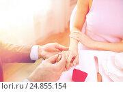 Купить «close up of man putting ring to his fiance finger», фото № 24855154, снято 9 марта 2014 г. (c) Syda Productions / Фотобанк Лори