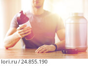 Купить «close up of man with protein shake bottle and jar», фото № 24855190, снято 14 мая 2015 г. (c) Syda Productions / Фотобанк Лори