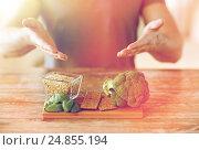 Купить «close up of male hands showing food rich in fiber», фото № 24855194, снято 14 мая 2015 г. (c) Syda Productions / Фотобанк Лори